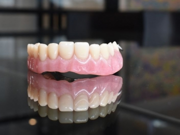 Are dentures better than implants?